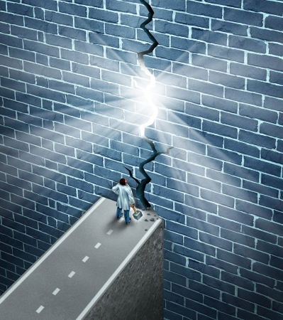 Medical research breakthrough as a health care and medicine science discovery concept as a doctor holding a sledge hammer breaking down a brick wall obstacle as a metaphor for finding a cure to disease with new technology  photo
