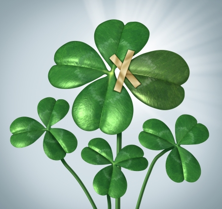 obtain: Create your success and taking control of your destiny with a three leaf clover being changed to good luck four leaves by taping an extra petal to the plant as a business concept  of  empowerment and increasing chances for good fortune