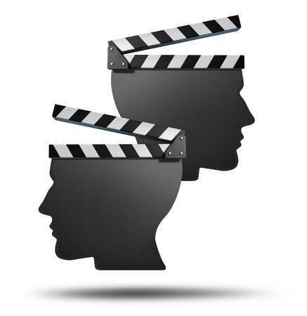 Movie partnership and film group agreement concept with two open cinema clapboards in the shape of a human head as an entertainment business team symbol of cinema production or contrasting creative direction and vision  photo