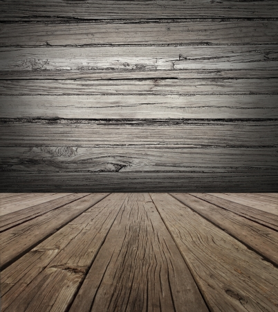 vertical: Old wood stage background with vertical natural distressed antique wooden plank floor and horizontal weathered wall as an aged grunge back drop  with copy space  Stock Photo