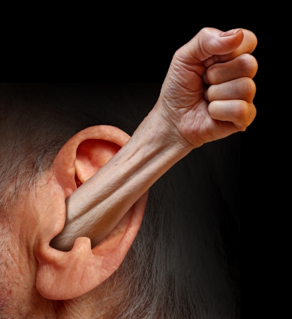 Power of being listened to and being heard as a social psychology concept of communication respect fighting for the rights of people and emotions as an arm with a fist emerging out of a human ear  photo