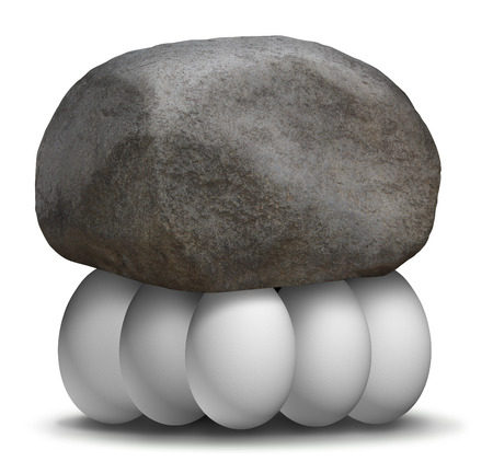 coming together: Group strength organization business concept with a rock or boulder being lifted and supported by a team of white eggs working together to create a strong partnership to achieve greater goals in solidarity