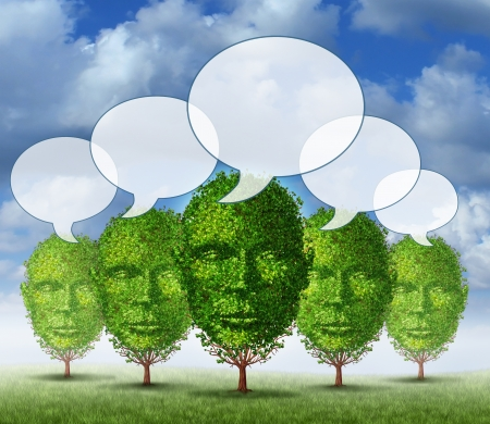Growing communication community as a business concept with a group of trees that are in the shape of a human head with connected speech bubbles as a symbol of people communicatiing in a growing social network  photo
