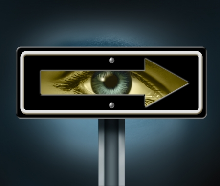business direction: Visionary direction with a human eye peeking through a hollow traffic arrow sign as a business symbol and life concept for leadership direction focused on success with a clear goal  Stock Photo