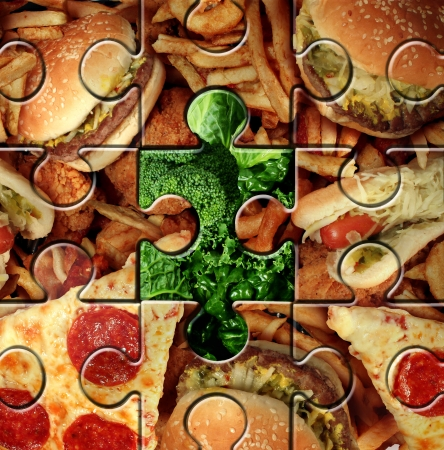 healthier: Breaking bad eating habits and choosing the healthy food for a healthier lifestyle as a junk food jigsaw puzzle with one piece replaced with green vegetables as a symbol for changing your diet