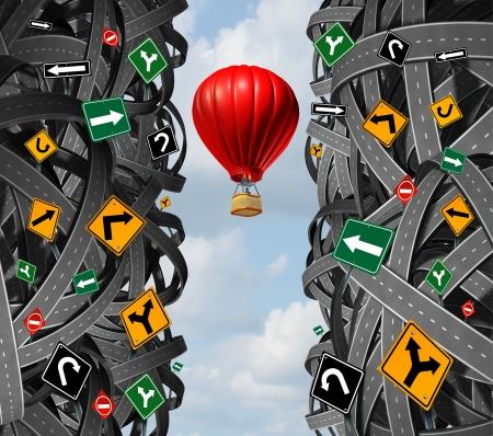 上向きの飛行しもつれた道路の混乱をエスケープと概念と障害を無視して、逆境を克服するためのメタファーとしての交通標識の混乱の熱気球の実 写真素材
