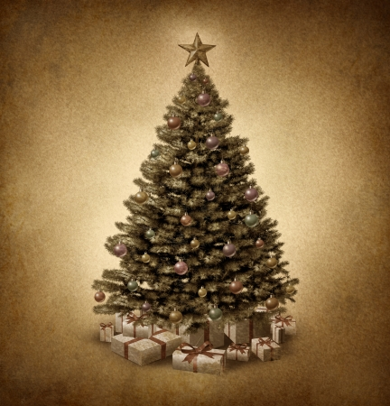 Old fashioned Christmas tree on vintage parchment paper grunge texture with traditional ornate decorative balls and gifts with ribbons and bows as a clasic seasonal symbol of winter celebration and festive new year  photo