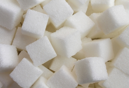 sweeten: Sugar cube food ingredient background with a close up of a pile of sweet white lumps of cubes as a symbol of cooking and baking and the diet health risks related to diabetes and calorie intake  Stock Photo