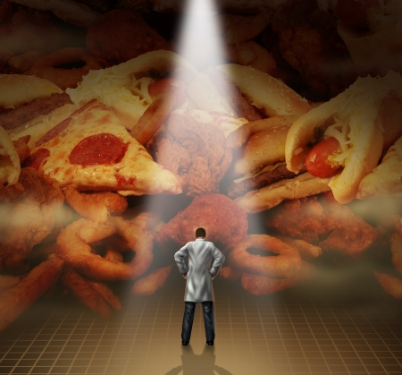 Medical diet advice health care concept with a doctor or dietician standing in front of a mountain of greasy junk food as hamburgers hotdogs and french fries