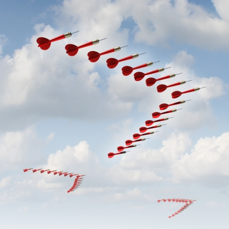 adapting: Mobile strategy as a business concept and metaphor with a group of organized red darts in a migratory bird formation as a symbol of changing course and adapting to new economic conditions and searching new goals and aiming for opportunities  Stock Photo