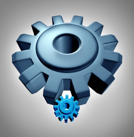 miniaturization: Young leader or apprentice business technology concept with a symbol of an older experienced  giant gear or cog teaching a small confident young  machine wheel the skills of industry success to a student learning the power of leadership  Stock Photo