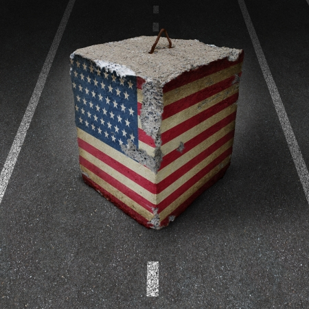 roadblock: United States government shutdown roadblock obstacle and barrier business concept with a huge cement or concrete cube with an old American flag blocking a road or highway as a symbol of political gridlock resulting in financial system shutdown