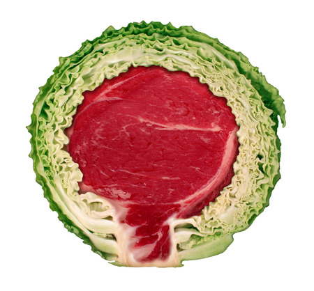 cheated: Vegetarian cheating concept eating fresh vegetables living a vegan lifestyle but sneaking in some red meat as a cut cabbage with a beef steak hidden inside as a metaphor for secretly eating animal products isolated on white  Stock Photo