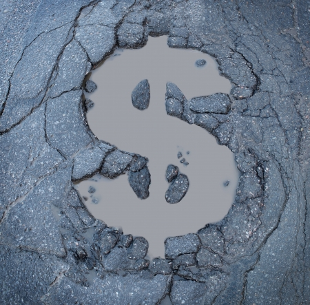 Infrastructure costs and road construction and repair budget as a business symbol of  the expenses of fixing urban highways as an old asphalt street damaged with apothole in the shape of a dollar sign  Stock Photo - 23446880