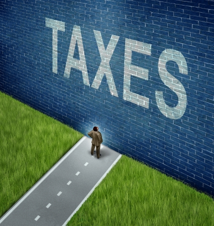 Tax problems business and financial concept as a businessman on a road to success blocked by a brick wall with the word taxes painted on the surface as a metaphor for finance issues as an adversity to growth