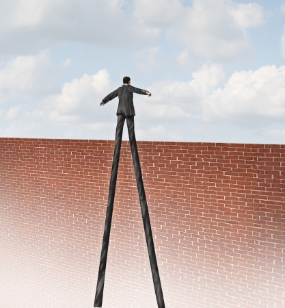 business metaphore: Rise to the challenge and adapt to adversity going over the wall business concept with a businessman with very long legs reaching the edge of a tall brick wall as a metaphore for freedom and success with a qualified leader