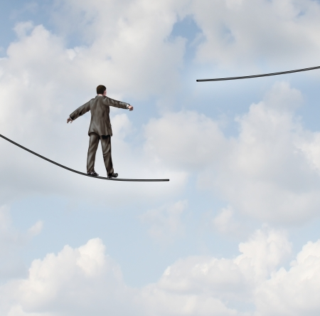 difficult journey: Difficult situation business concept with a businessman walking on a tightrope or high wire metaphor that has been cut and moved higher resulting in increased risk and danger to a planned strategy  Stock Photo