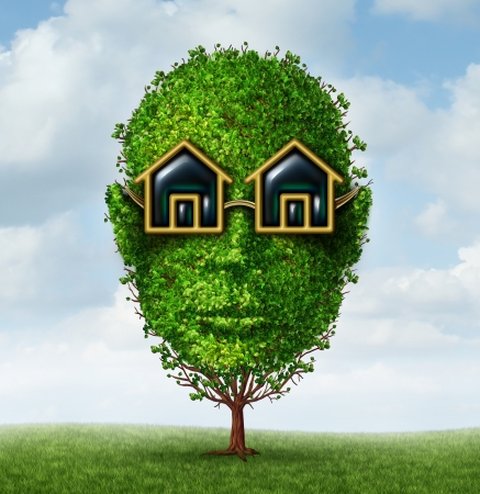 head home: Real estate planning concept as a green tree shaped as a human head with eye glasses in the shape of a home or house as a symbol of visionary investment strayegy for a growing new residential construction project