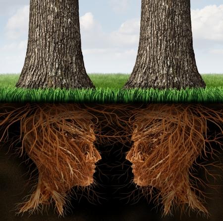 Zakelijke wortels concept als een samenwerkingsverband van twee groeiende bomen met hun wortels in de vorm van een menselijk hoofd als een metafoor voor teamwork contract en overeenkomst door middel van communicatie netwerkverbindingen, Stockfoto