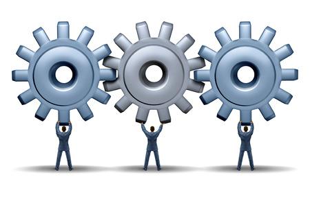Lavoro di squadra conseguimento concetto di business con un gruppo di lavoro di tre uomini d'affari in possesso di ingranaggi e ruote dentate collegate insieme in una rete per il successo finanziario attraverso la cooperazione e la pianificazione come una squadra