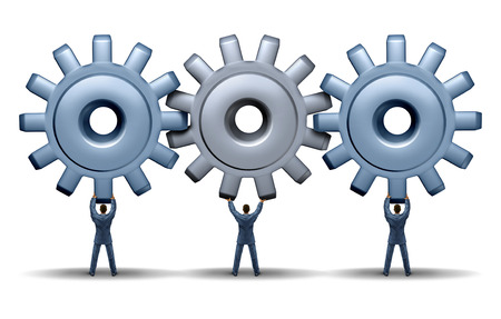 Teamwork achievement business concept with a working group of three businessmen holding up gears and cog wheels connected together in a network for financial success through cooperation and planning as a team