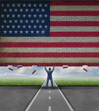 Break into the American market business concept with a businessman lifting up a brick wall with the flag of the United States painted on the surface as a metaphor for access to free trade and new investment opportunity  photo