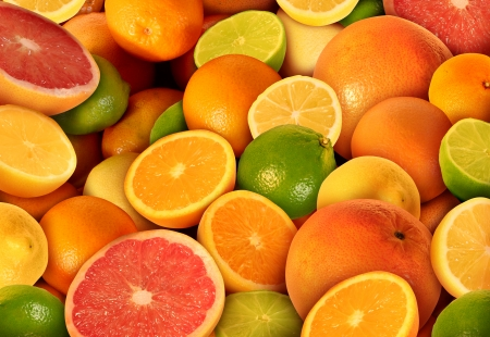 c vitamin: Citrus fruit background with a group of cultivated and harvested oranges lemons lime pomelo tangerines and grapefruit as a symbol of healthy eating and immune system boost eating fresh juicy health fruit full of natural vitamins