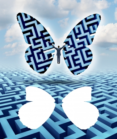 thinking out of the box: Freedom and creativity as an innovative businessman thinking outside the box escaping a maze or labyrinth by cutting out butterfly wings and taking flight overcoming adversity towards his journey to success
