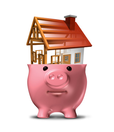 Home savings concept and saving for a house that is being built from a construction project in an open piggy bank as a symbol for a family residence or managing budget funds for renovations on a white background Stock Photo - 24220568
