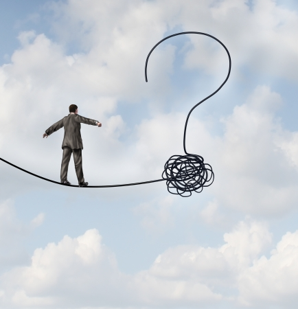 unsure: Risk uncertainty and planning a new journey as a businessman walking on a tight rope that getets tangled and shaped as a question mark as a metaphor for confusion at the road ahead as a business concept of finding solutions to change for success