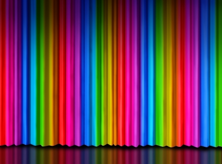 Rainbow curtain on a theater or theatre stage as a symbol of creative entertainment or important message presentation with spectrum colored drapes as red purple yellow green and blue silk material  photo