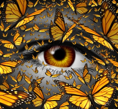 Communication freedom business and lifestyle concept with a close up of  human eye and a group of monarch butterflies flying as a creative metaphor for the liberty of  imagination expression and innovative vision