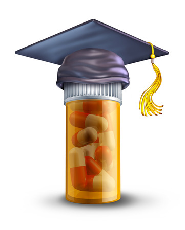health education: Medicine school and medical education concept with a gaduation mortar cap on a prescription pill bottle as an icon of health care drug training for doctors or pharmacists prescribing therapy