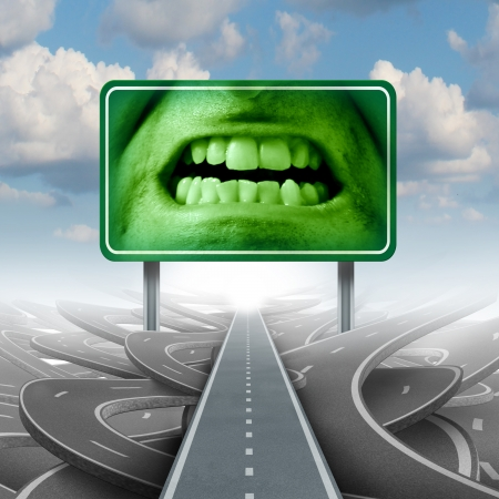 Road rage concept with a group of streets or highways and a traffic sign with an human expression of extreme anger as a symbol of emotional driving stress disorder as a mental health issue  photo
