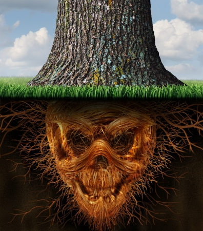 fooling: Hidden danger and risk  as a business concept as a growing tree trunk with underground plant roots shaped as an evil human skeleton skull as a symbol of dishonesty and dangers of fraud