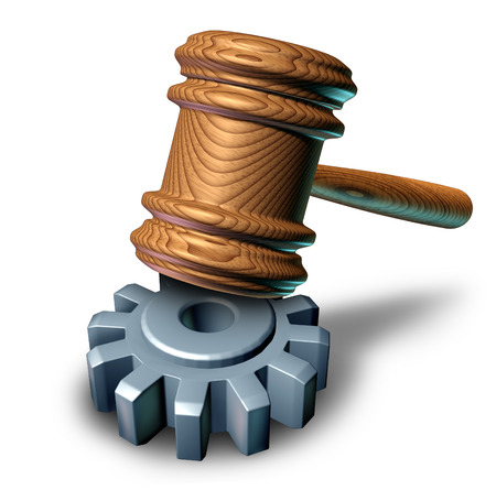 lawsuit: Business law concept with a judge mallet or judges wooden gavel hammering a metal gear or cog wheel as a metaphor for corporate regulations and legal lawyer or attorney guidance for companies  Stock Photo