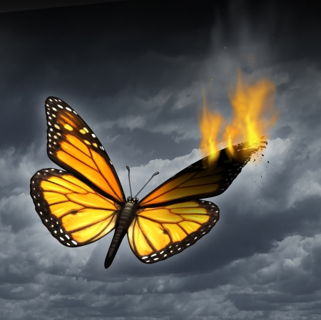 heartbreak issues: Creative crisis business concept as a monarch butterfly in distress with a burning wing as a metaphor for problems in creativity and managing human sadness and depression