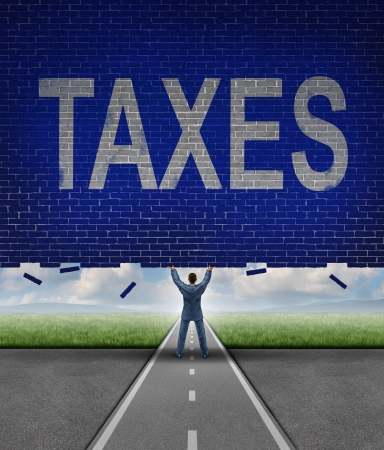 Tax advice from a financial advisor as a businessman lifting up a brick wall obstacle with the word taxes on the textured surface as a metaphore for managing a budget and reducing costs Stock Photo - 24809493