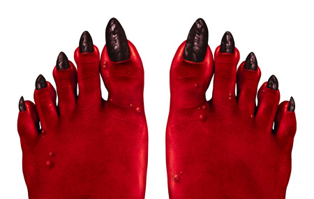 monster movie: Devil feet and red zombie feet as a creepy Halloween