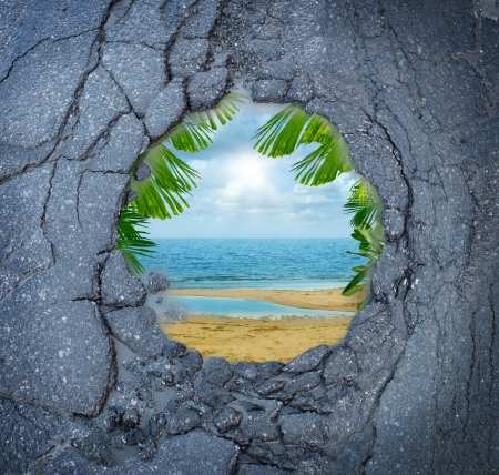 pot hole: Escape city stress vacation dreaming as a dirty road pothole with the magical reflection of a tropical beach paradise scene as a metaphor for leisure holiday break from urban decay anxiety  Stock Photo