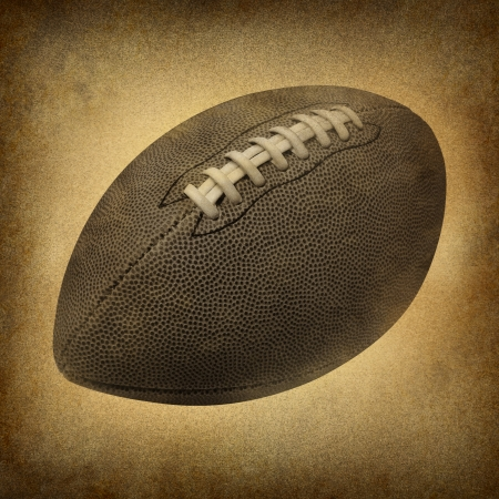 passtime: Old grunge football as a vintage antique sports symbol on a dirty parchment  an American cultural and traditional national game and sport with leather and stitching  Stock Photo