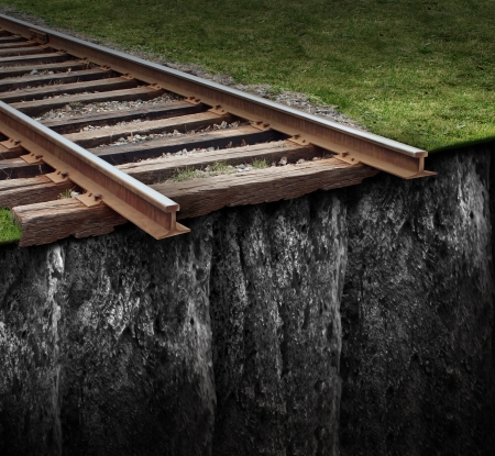edge: Out of track with a train railway at the edge of a steep cliff as a journey that has been cut abruptly as a closed business concept and metaphor for ending the path due to the lack of support and economic challenges  Stock Photo