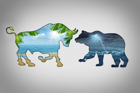 Market climate economy concept with a tropical beach paradise scene contrasted with a stormy lightning cloud night in the shape of a bull and bear as financial business metaphors for bullish versus bearish trading sentiment