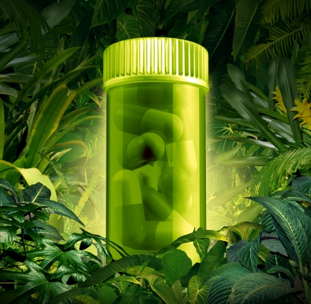drug discovery: Medicinal plants and jungle medicine discoveries as a health care symbol of natural herbal remedies found in a rain forest as a pharmacy metyaphor of the  natural world as a prescription pill bottle with green pills over growing plants  Stock Photo