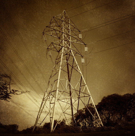 electric grid: Electric power tower and electricity  distribution network on a grunge vintage texture as a symbol of energy and the electrical grid infrastructure