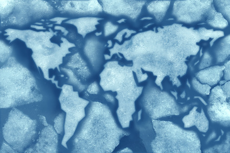 Global freeze climate change concept with broken ice in cold freezing water shaped as a world map symbol as a metaphor for record breaking frigid below zero weather affecting the temperature of the planet  photo