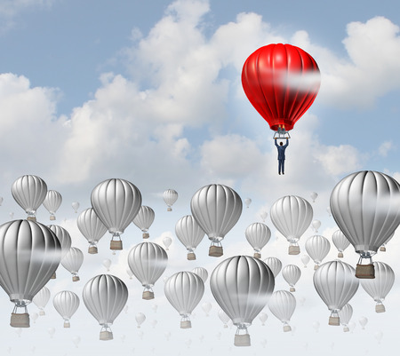 The best leadership concept with a group of grey hot air balloons in the sky and a red aircraft guided by a business leader rising above the competition as a success metaphor for leadership  Фото со стока