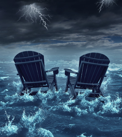 Retirement crisis concept as a couple of adirondack chairs sinking in the ocean during a thunder storm as a metaphor for financial investment problems for retiring seniors who lost their savings or broken dreams symbol
