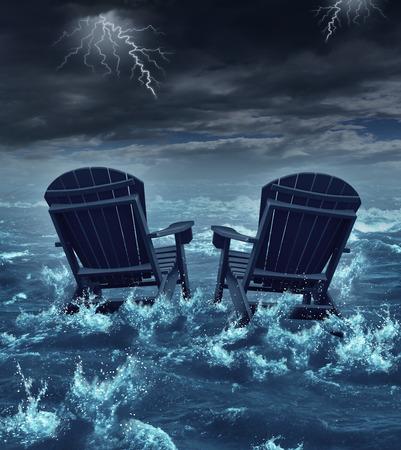 Retirement Krise Konzept wie ein paar Adirondack Stühle sinken in den Ozean während eines Gewitters als Metapher für die finanzielle Investition Probleme für den Ruhestand Senioren, die ihre Ersparnisse oder zerbrochene Träume Symbol verloren Standard-Bild