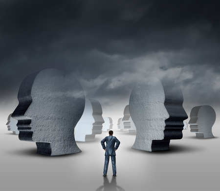 Recruitment strategy and human resources business concept as a businessman standing in front of a landscape with three dimensional head sculptures as symbols of employment hiring and career issues  Banco de Imagens